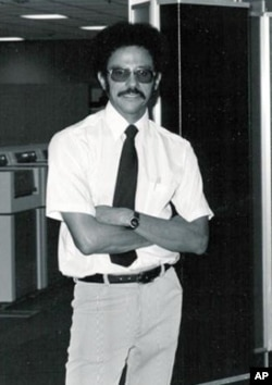 Warren Washington standing in front of one of the first Cray computers in 1970.