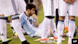 Argentina's Lionel Messi waits for trophy presentations after the Copa America Centenario championship soccer match, Sunday, June 26, 2016, in East Rutherford, N.J.