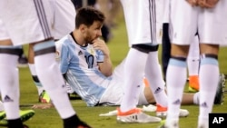Argentina's Lionel Messi waits for trophy presentations after the Copa America Centenario championship soccer match, Sunday, June 26, 2016, in East Rutherford, N.J. Messi was sentenced to 21 months in prison on Wednesday for his role in tax fraud in Spain. (AP Photo/Julie Jacobson)