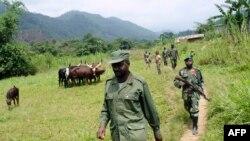 """Le général Janvier Buingo Karairi, le chef des Maï Maï, terme collectif désignant plusieurs groupes paramilitaires disparates prétendant défendre des communautés ethniques particulières, groupe """"l'Alliance des Patriotes pour un Congo libre et souverain."""