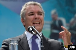 FILE - Colombian President Ivan Duque speaks during a ceremony for the recognition of command of the Military Forces at the Jose Maria Cordova Military School in Bogota, Dec. 17, 2018.