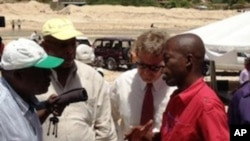 Engineer Denis explaining completed works to Mr. Jean Robert Estimé, WINNER COP, Mr. Vernet Joseph, Secretary of State to agriculture renewal and to Mr. Herbert Smith, USAID Acting Director.
