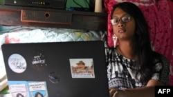 FILE - Rukshana Kapali, a transgender woman, works on her computer at her home in Patan near Kathmanduin, Nepal, this Aug. 29, 2018 photo.