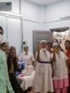 Health workers celebrate India administering 1 billion doses of COVID-19 vaccine, at Rajawadi hospital in Mumbai, India, Oct. 21, 2021.