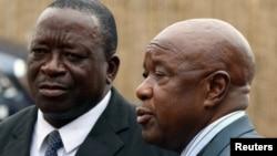 Under pressure: Zimbabwean War Veterans leaders Chris Mutsvangwa (R), annd Victor Matemadanda (L)
