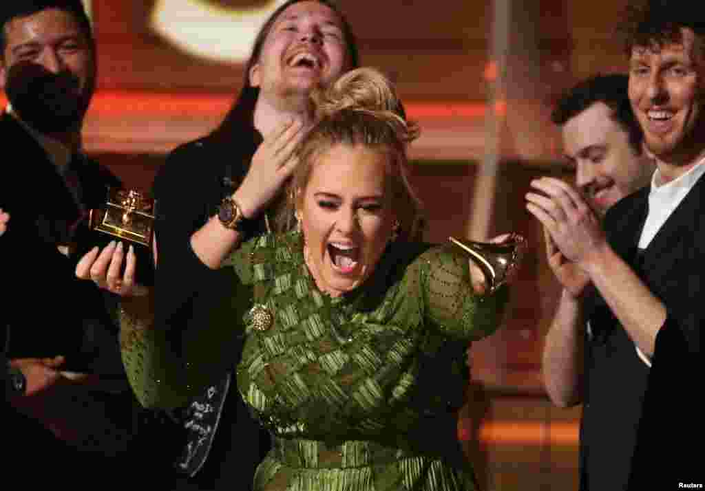 "Adele breaks the Grammy for Record of the Year for ""Hello"" at the 59th Annual Grammy Awards in Los Angeles, California, Feb. 12, 2017."