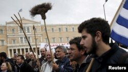 Greek farmers take part in a demonstration against planned pension reforms in front of the parliament building in Athens, Greece, Feb. 13, 2016.