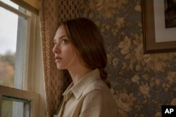 "Amanda Seyfried in a scene in the film ""Things Heard And Seen"" (Anna Kooris / Netflix via AP)"