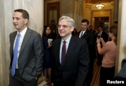 FILE - US. Supreme Court nominee Judge Merrick Garland walks after a breakfast with Senate Judiciary Committee Chair Senator Chuck Grassley (R-IA) on Capitol Hill Washington, April 12, 2016.