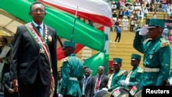 Madagascar's new president Hery Rajaonarimampianina attends his inauguration ceremony at the Mahamasina Stadium in the capital Antananarivo January 25, 2014. Rajaonarimampianina, who won the first elections since a coup in 2009, took office on Saturday bu