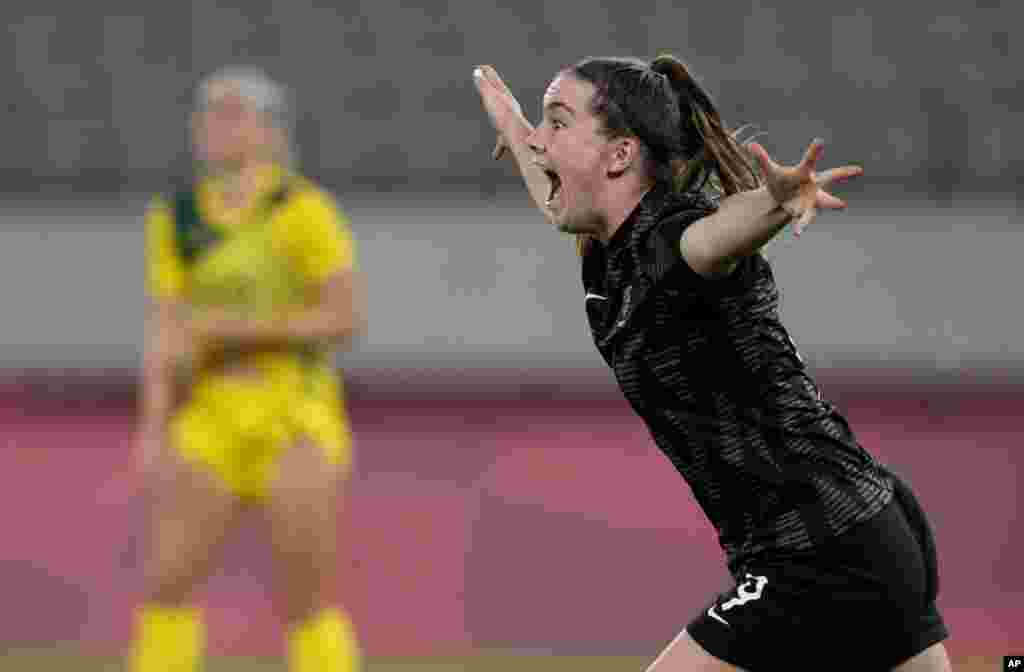 New Zealand's Gabi Rennie, right, celebrates after scoring her side's first goal during a women's soccer match against Australia at the 2020 Summer Olympics in Tokyo, Japan.