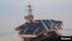 ກຳປັ່ນບັນທຸກເຮືອບິນ USS George H.W. Bush (ລຸ້ນ CVN 77) ທີ່ຖືກສັ່ງໃຫ້ເຄື່ອນເຂົ້າໄປ ຍັງເຂດອ່າວເປີເຊຍ.