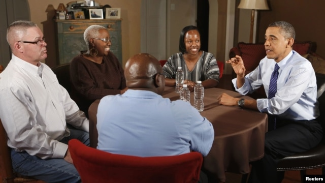 U.S. President Barack Obama visits members of middle class families to discuss his Administration's push to cut taxes for 98% of Americans while visiting in Fairfax County, Virginia, December 6, 2012.