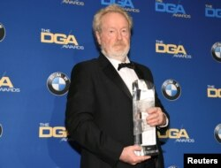 FILE - Ridley Scott, winner of the Lifetime Achievement in Feature Film Award, poses for photographers at the 69th annual DGA Awards in Beverly Hills, California, Feb. 4, 2017.