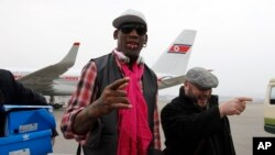 Former NBA basketball star Dennis Rodman, third left, and his entourage arrive at the international airport in Pyongyang, North Korea, Monday, Jan. 6, 2014.