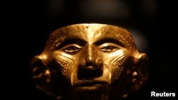 A pre-Columbian gold mask. This artifact is secure in a Colombian museum, but similar objects are sometimes smuggled out of their countries of origin and sold to collectors.