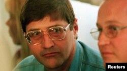 Eugene de Kock, à esquerda, Pretoria Set. 14, 1998.