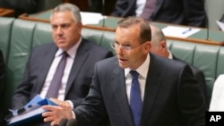 FILE - Australia's Prime Minister Tony Abbott speaks about the nation's new anti-extremism strategy during a question time at Parliament House in Canberra, Feb. 23, 2015.