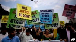 FILE - Pakistani protesters stage a rally demanding a trial for American diplomat involved in a vehicle crash that killed a person, in Islamabad, Pakistan, April 10, 2018. Two people were injured Sunday in a second such incident involving a U.S. diplomat.