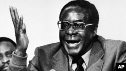 FILE: Robert Mugabe co-leader of the Patriotic Front guerrilla forces, is seen at a press conference in London, Dec. 19, 1979, when it was announced that he and Joshua Nkomo had reached an agreement at Lancaster House on a new constitution and a ceasefire.