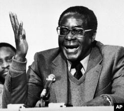 FILE: Robert Mugabe co-leader of the Patriotic Front guerrilla forces, is seen at a press conference in London, Dec. 19, 1979, when it was announced that he and Joshua Nkomo had reached an agreement at Lancaster House on a new constitution.