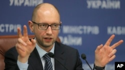 FILE - Ukrainian Prime Minister Arseniy Yatseniuk speaks to the media during a press conference in Kyiv, Ukraine, Nov. 20, 2014.