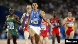 South Africa's Hezekiel Sepeng and Italy's Andrea Longo run in men's 800 meters at the Athens 2004 Olympic Games.