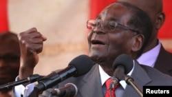 FILE - Zimbabwe President Robert Mugabe gestures as he addresses supporters of his ruling ZANU-PF party at Harare International Airport, Zimbabwe, Sept. 24, 2016.