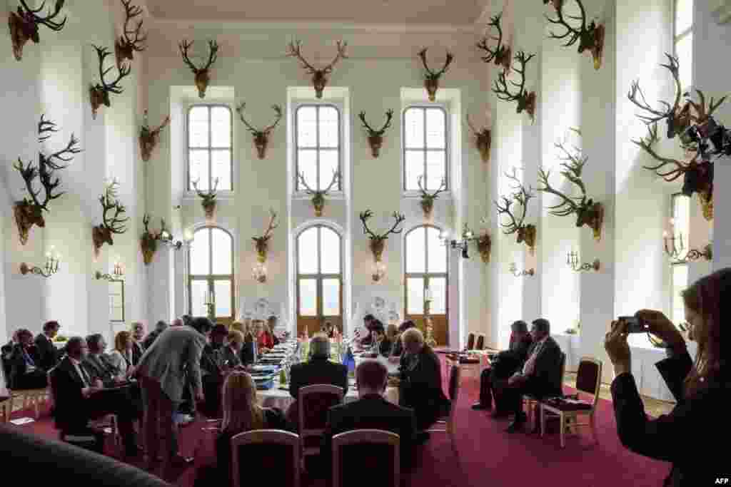 The participants of a two-day meeting of interior ministers of so-called G6 group sit around the table at the Moritzburg Castle near Dresden, Germany.