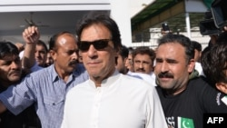 FILE - Pakistan opposition leader and head of the Pakistan Tehreek-e-Insaf (PTI, Pakistan Movement for Justice) political party Imran Khan leaves Parliament after attending a session in Islamabad, May 23, 2018.