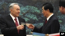 Kazakhstan's President Nursultan Nazarbayev and his Chinese counterpart, Hu Jintao, toast during a signing ceremony at the Great Hall of the People, Beijing, Feb. 22, 2011.