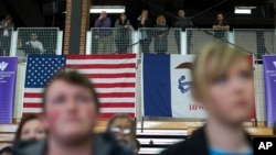 Voters look on as Democratic presidential candidate Sen. Bernie Sanders speaks during a campaign a campaign event, Jan. 29, 2016, in Mt. Pleasant, Iowa