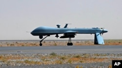FILE - U.S. Predator unmanned drone armed with a missile.