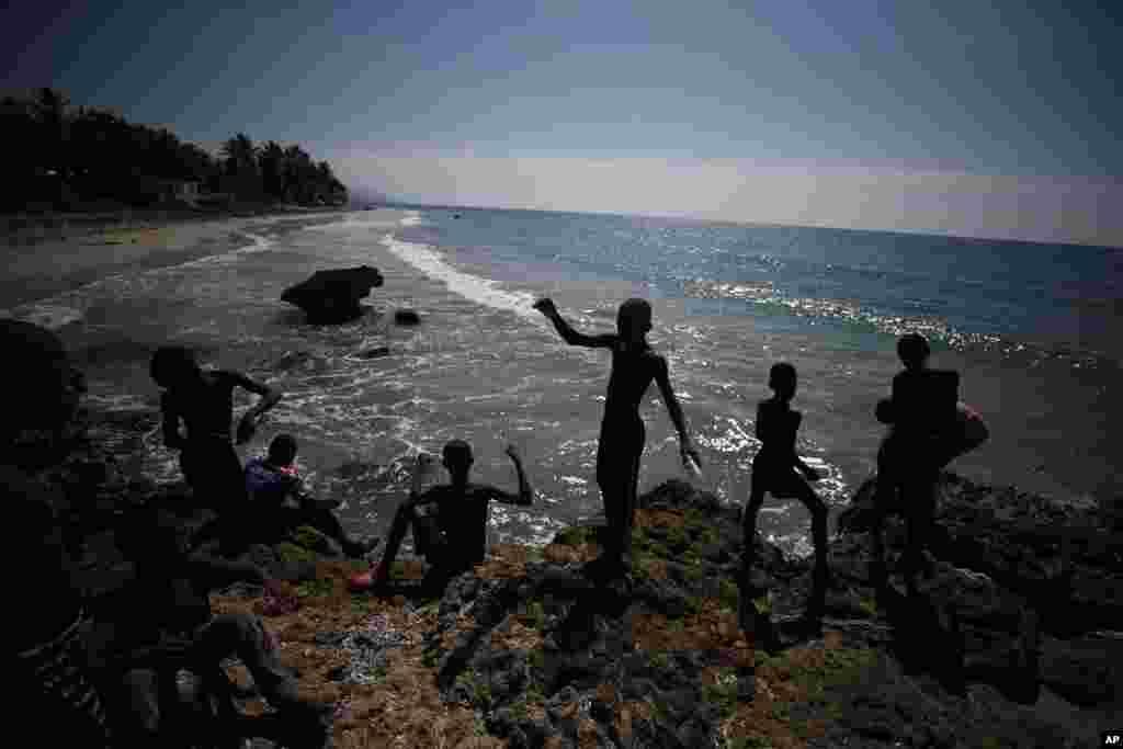 Boys are fish on the coast near Jacmel, Haiti, Oct. 6, 2019.