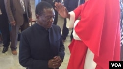 FILE: Vice president Emmerson Mnangagwa praying at a Catholic Church.