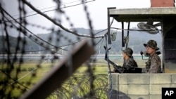 FILE - South Korean army soldiers stand guard at a military check point at the Imjingak Pavilion near the border village of Panmunjom, which has separated the two Koreas since the war.