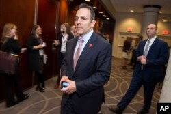 Kentucky Gov. Matt Bevin leaves a governors lunch during the National Governors Association Winter Meeting in Washington, Saturday, Feb. 25, 2017.