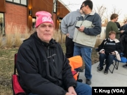 "Ed Hotchkin voted for Hillary Clinton in the 2016 election, but he is eyeing Senators Bernie Sanders and Elizabeth Warren this time. He attended the Warren rally in Des Moines, Jan. 5, 2019, in a pink ""2010 Feel The Bern! hat."
