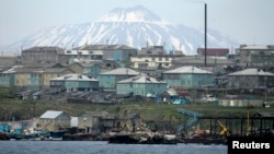 FILE - Kunashiri Island, one of four islands known as the Southern Kurils in Russia and Northern Territories in Japan