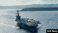 """美军""""罗斯福""""号(USS Theodore Roosevelt)航母2020年5月21日驶离关岛,前往菲律宾海执行任务。"""