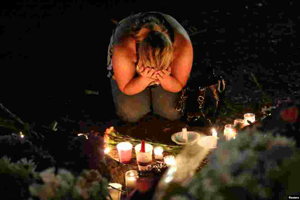A woman mourns during a vigil for Pulse nightclub victims following last week's deadly shooting in Orlando, Florida, June 19, 2016.