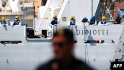 Italy's Diciotti coast guard vessel, carrying 67 asylum seekers, waits in Trapani port, July 12, 2018.