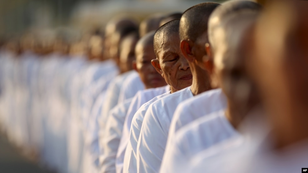 FILE-Hundreds of Buddhist nuns wait in line at the Royal Palace to pay their respects to the late former Cambodian King Norodom Sihanouk in Phnom Penh, Saturday, Feb. 2, 2013.