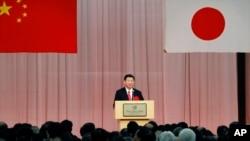 VOA连线(歌篮):习近平接见日本执政党高官,中日关系升温?