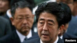 FILE - Japan's Prime Minister Shinzo Abe speaks to the media.