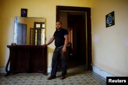 Self-employed Antonio Viltres shows the living room of his home which is being prepared to become a bed-and-breakfast and coffee shop, in Havana, Cuba, Aug. 1, 2017.