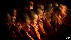FILE - Buddhist nuns.
