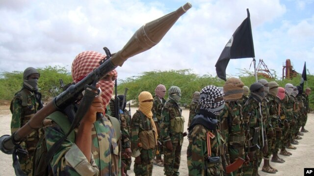 Al-Shabaab fighters display weapons as they conduct military exercises in northern Mogadishu, Somalia, Oct. 21, 2010.