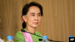 FILE - Myanmar's opposition leader Aung San Suu Kyi is seen in a Nov. 13, 2014, image in Naypyitaw, Myanmar.