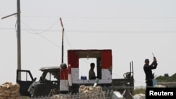 Egyptian soldiers are seen near the Kerem Shalom crossing, a zone where the Israeli, Egyptian and Gaza borders intersect, August 8, 2012.